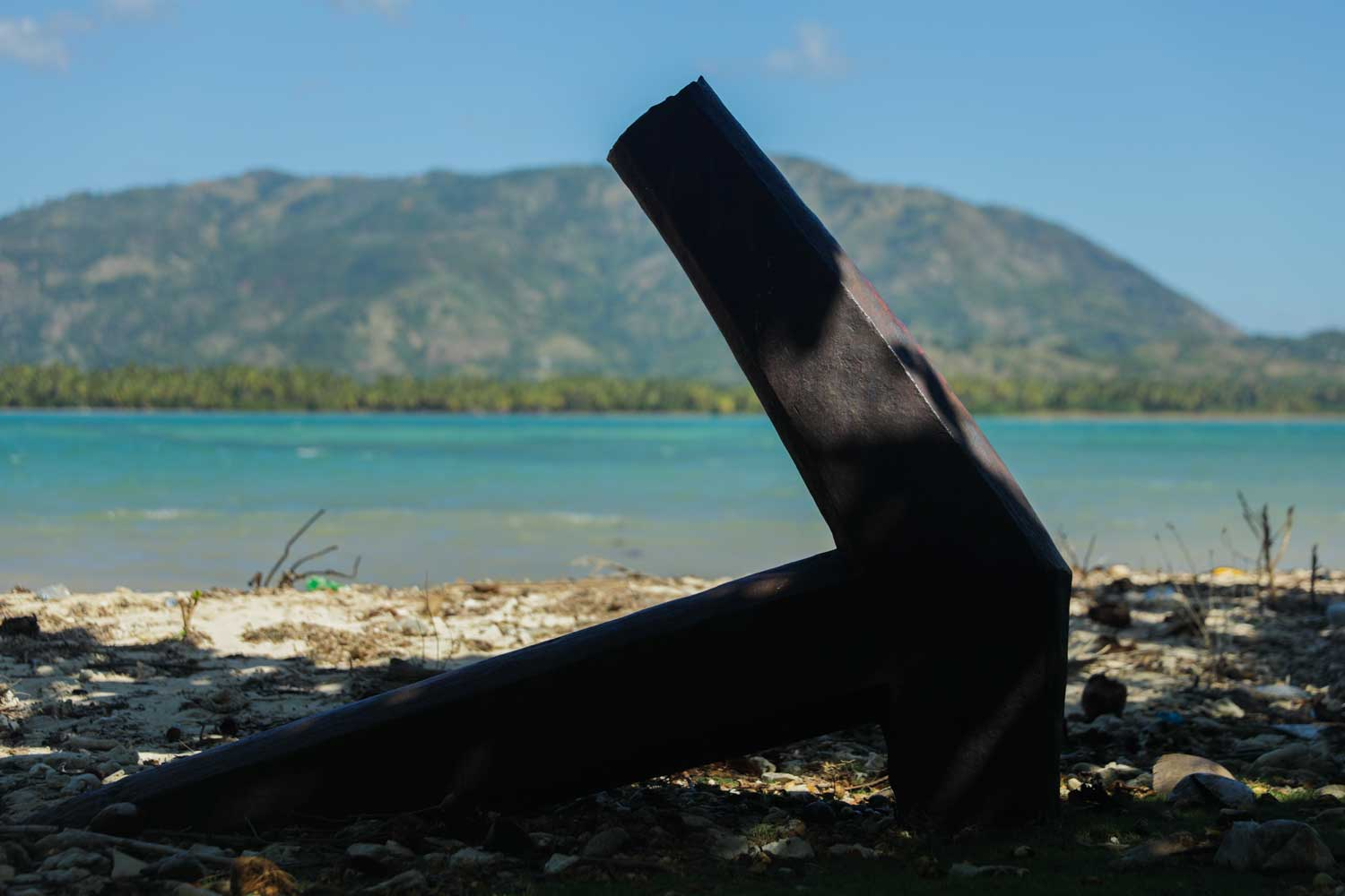 Anchor embedded in the beach at Fort des Anglais, Haiti