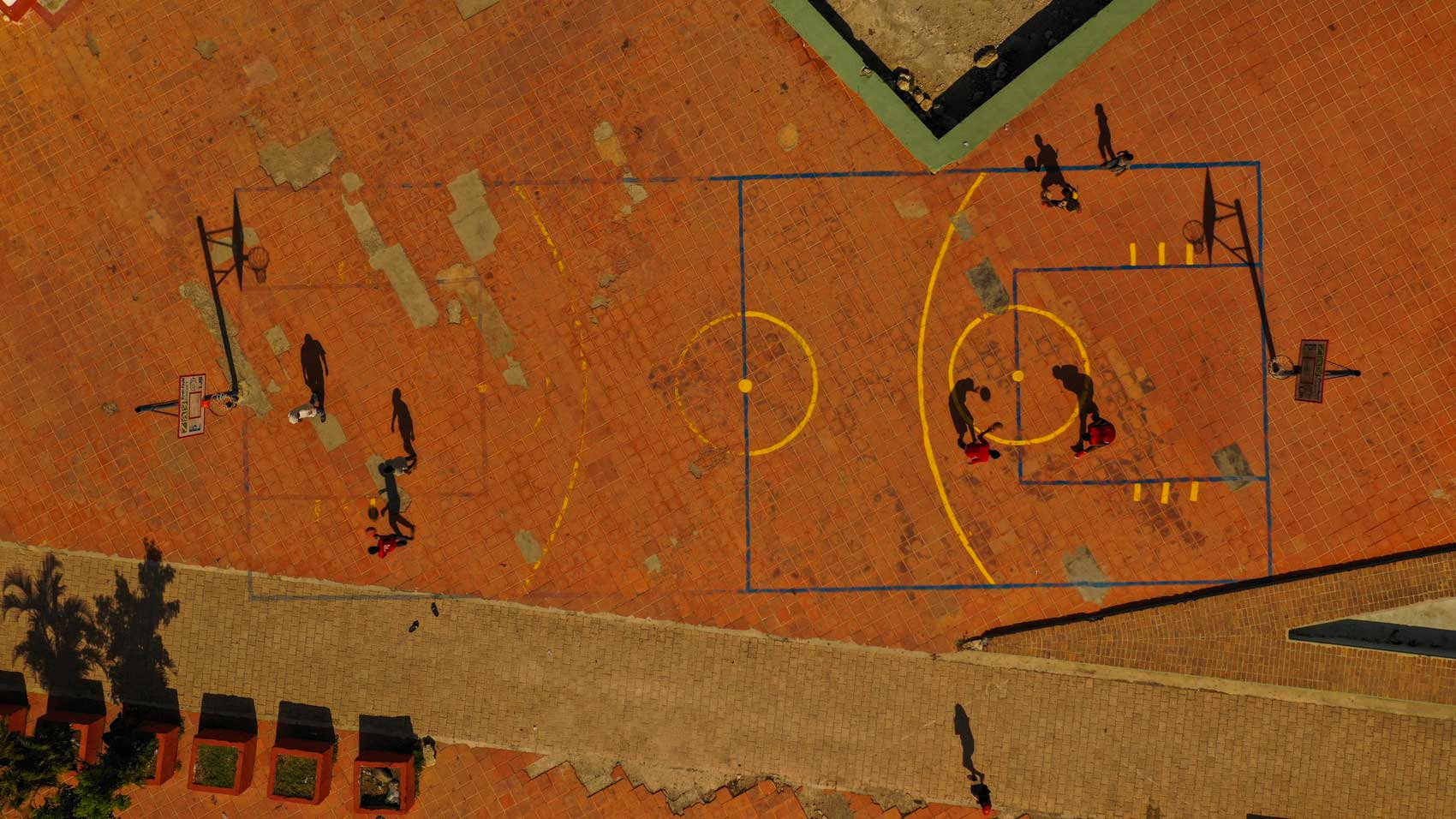 Aerial view of basketball players practicing on a court in Jacmel, Haiti