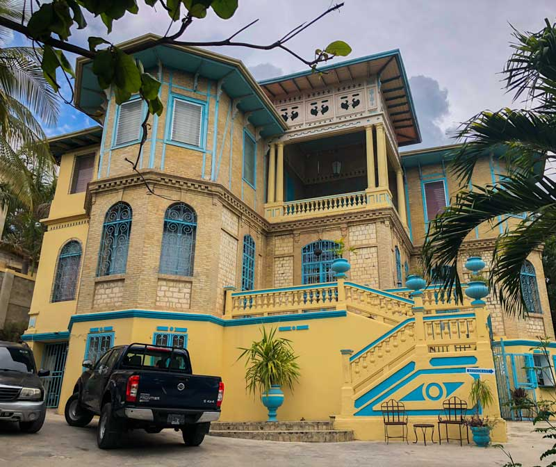 The yellow and blue exterior of Gingerbread Restaurant in Pacot, Port-au-Prince, Haiti