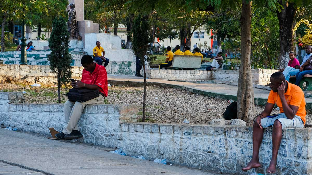 People hanging out in Place St. Pierre, Haiti