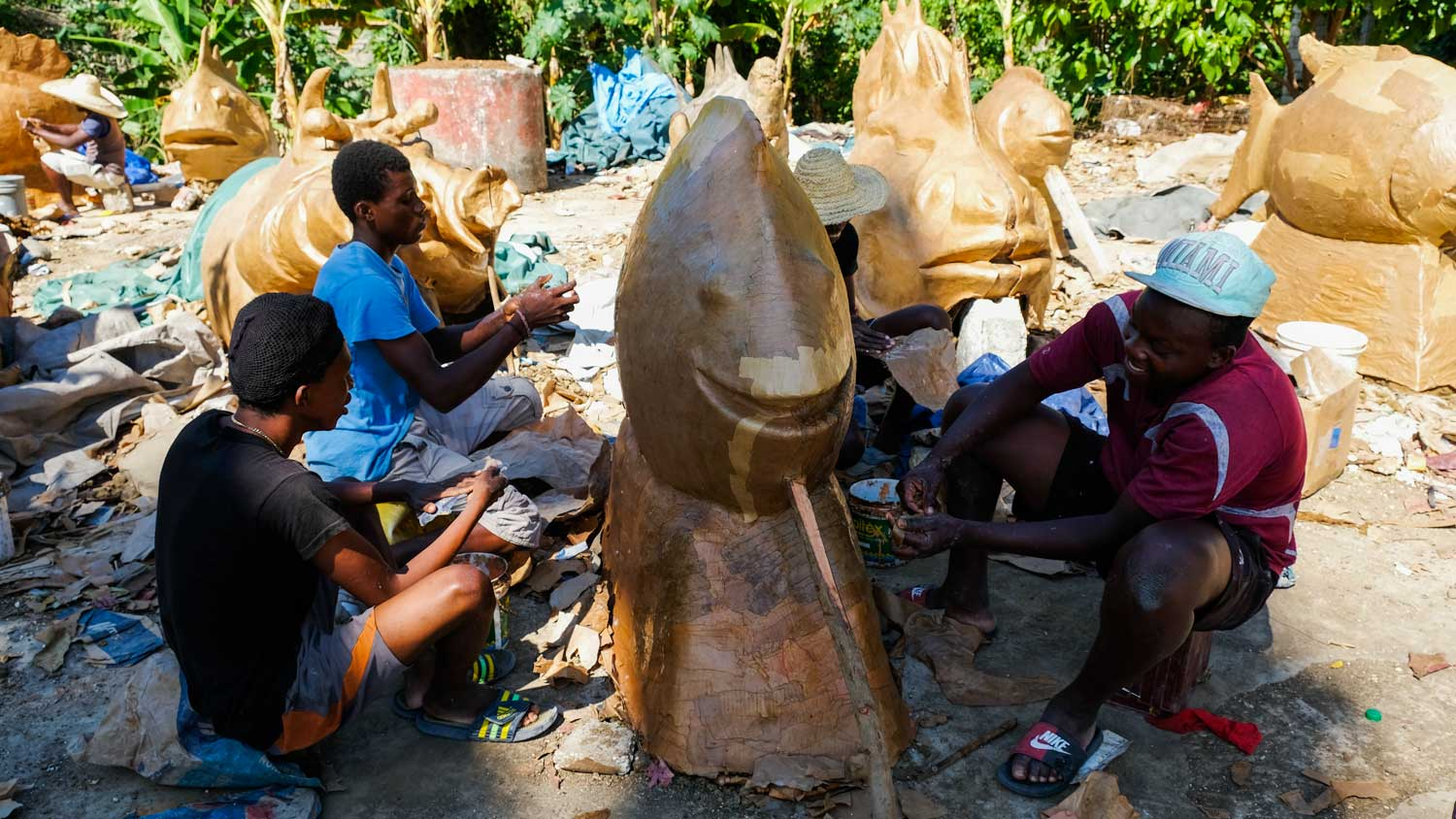 Artists in Jacmel, Haiti, working on paper mâché costumes