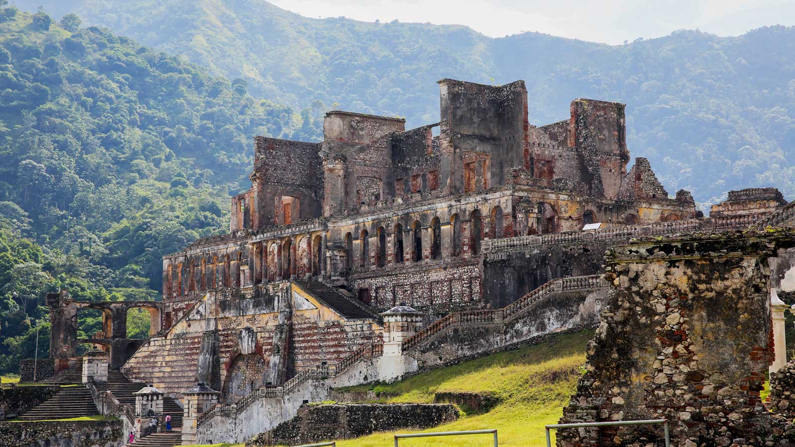 Photo of Sans-Souci Palace, Haiti, with tree-covered mountains in the background
